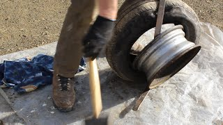 How to change a car/truck  tyre in 5 minutes using a garden spade and tyre levers