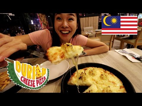 japanese-girl-goes-to-malaysia-just-to-eat-durian-pizza