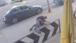 A fight stopped by pizza caught on CCTV
