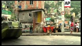 Police raid Rio's largest favela in security operation, AP cover