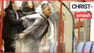 Woman SMASHES bottle on London tube showering passengers in shards of glass   SWNS TV