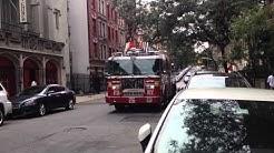 FDNY LADDER 26 CRUISING BY ON WEST 108TH STREET IN MORNINGSIDE, MANHATTAN IN NEW YORK CITY.