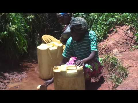 A MAN AND WOMEN FETCH WATER AT A CONTAMINATED WELL IN BUKIIRI VILLAGE BUGIRI DISTRICT