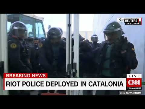 Riot police clash with Catalan independence voters in Spain