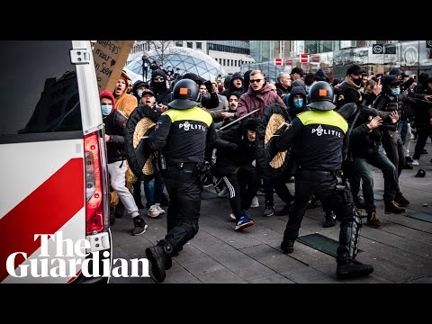Anti-lockdown rioters clash with Dutch police in two cities in the Netherlands