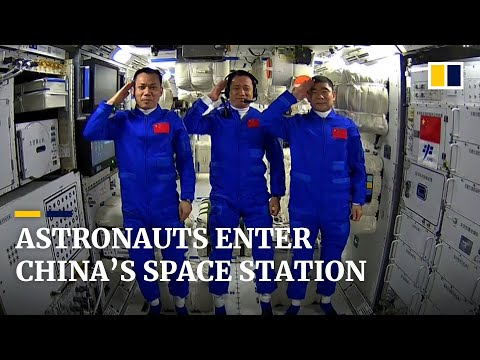Chinese astronauts explore space station that will be their home for three months