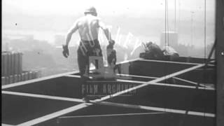 Men Walk on girders on New York Building Site.  Archive film 94160