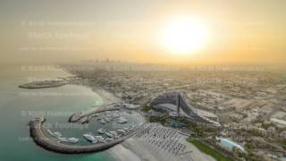 Beautiful Sunrise. Aerial View of Jumeirah Beach from Burj Al Arab, Dubai, UAE timelapse