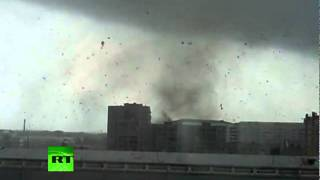 Amateur videos of powerful tornado that kills 1, injures dozens in Russia thumbnail