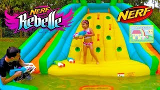Epic Nerf Battle with Water Toys on Inflatable Waterslide! Kid vs Dad