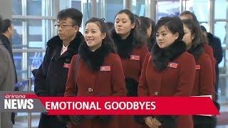 North Korean athletes and cheering squad return home