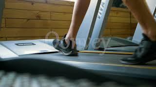 Gym Treadmill walking in slow motion revealing shot of man Stock Video | India | Qonvey
