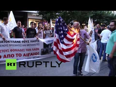 Protesters burn US, NATO flags during rally in Greece