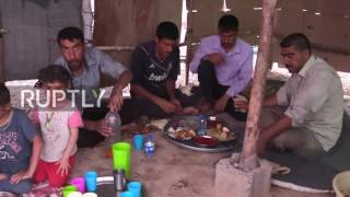 Iraq: Displaced family breaks the fast on the first day of Ramadan in the Khazar IDP camp