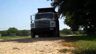 Dump Truck dumping gravel