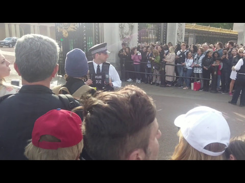 Police escorting Prince William out of Buckingham Palace in London