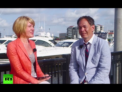 Keiser Report: Invasive species & 'Satoshi Forest' (E803)