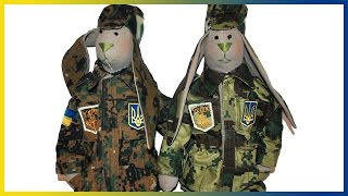 War in Ukraine  Ukrainian dolls in military camouflage uniforms. Tilda Dolls