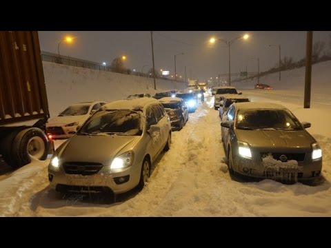 Two men died in car buried by Quebec blizzard