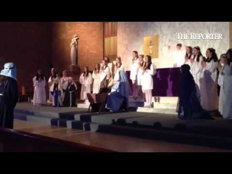 Mater Dei Catholic School celebrates the meaning of Christmas, featuring 8th grade students re-enact