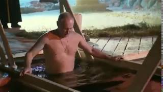 Putin hrabro ulazi u ledenu vodu tokom tradicionalnog Bogojavljenskog potapanja