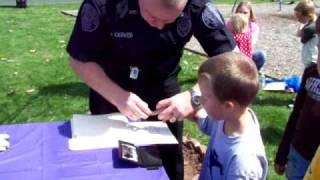 Trent getting fingerprinted by Flatwoods Policeman Joe Carter