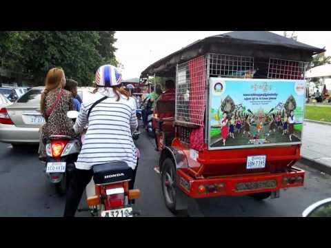 Tour of Phnom Penh on Sihanouk Blvd and Sisowath Quay on a Motorbike