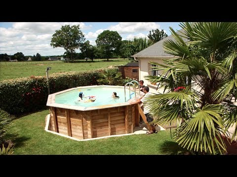 installation d 39 une piscine hors sol octogonale en bois. Black Bedroom Furniture Sets. Home Design Ideas