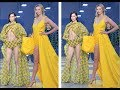 Karlie Kloss is unmissable as she wears a bright yellow dress