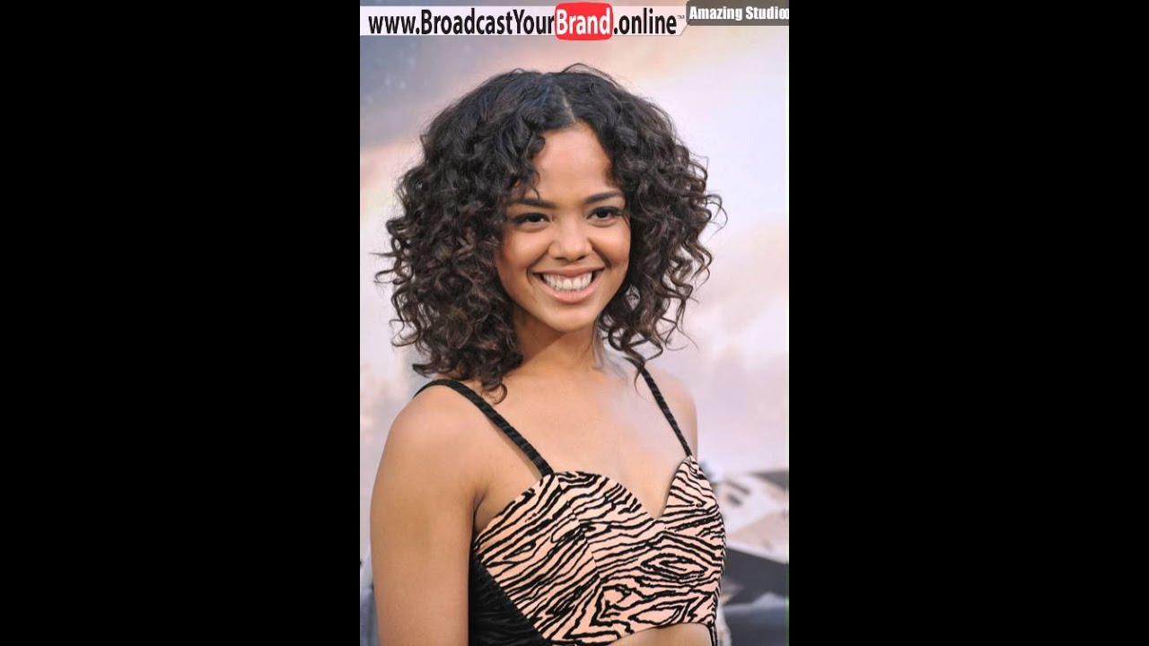 Medium Curly Wedding Guest Hairstyle For Black Women From