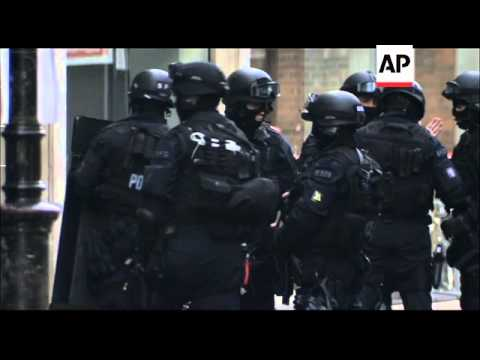 Armed police lay siege to building in Central London