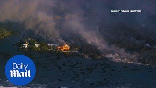 Aerial footage shows large lava flow wiping out homes in Hawaii
