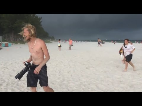Beachgoers flee as tropical storm Colin approaches...