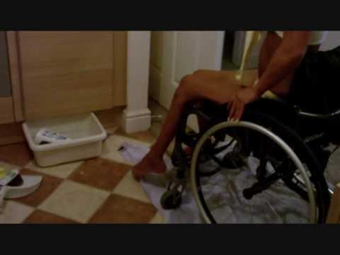 Blonde paraplegic transfer to ground 4