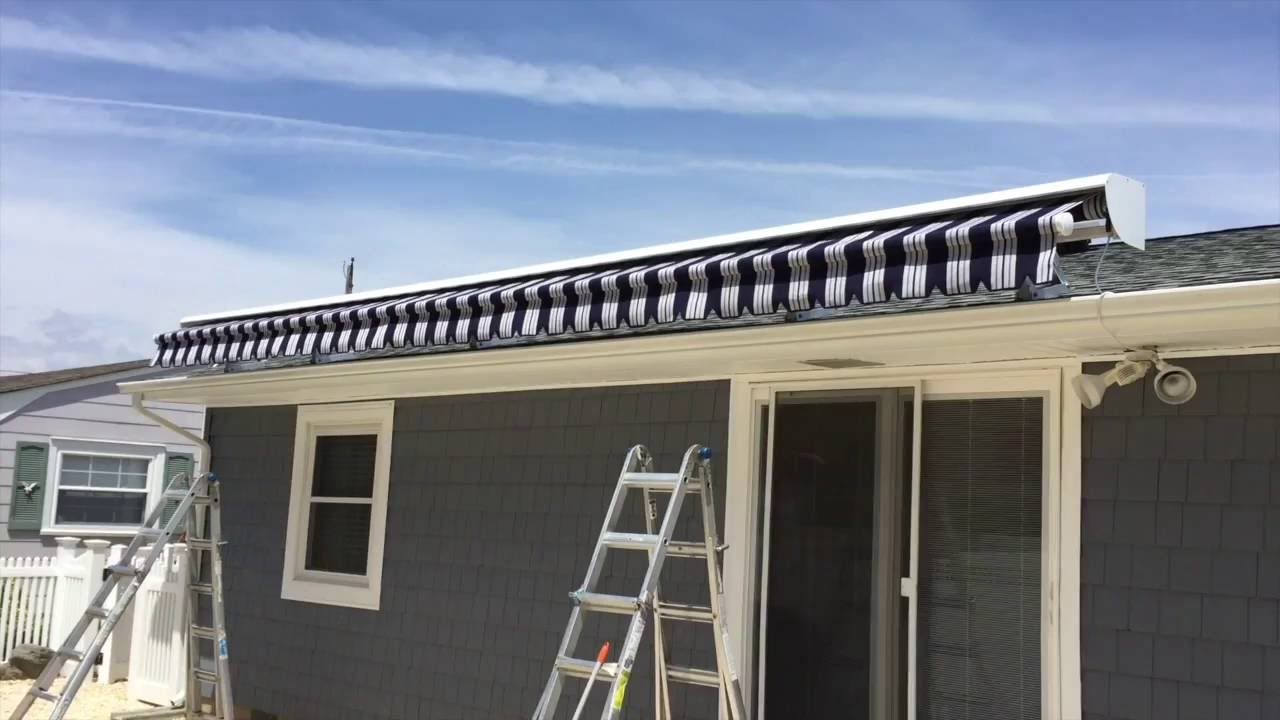 Large Roof Mounted Retractable Awning Installation ...