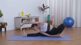 Closeup shot of young flexible girl practicing yoga postures on a fitness mat - health at home