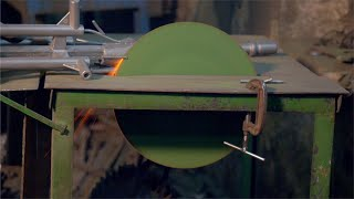 Metal cutting saw cutting a thin metal piece in factory