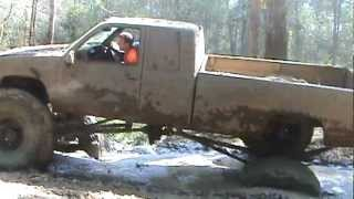 Big mud trucks almost flips in deep ruts
