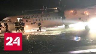 Самолет без переднего шасси экстренно приземлился в Варшаве - Россия 24