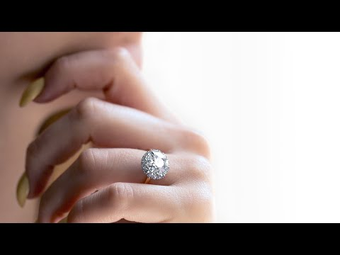 Antique diamond ring by Leon Megé r7174