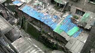 Illegal houses hide in row under China bridge