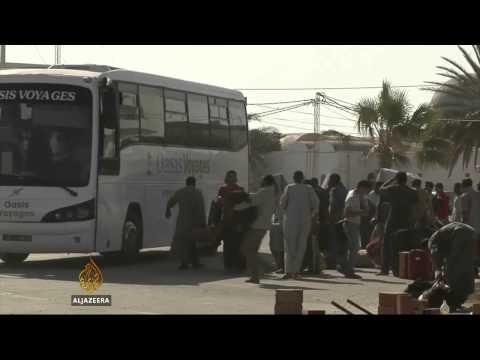 Tunisia seals Libya border after violence
