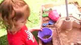 Kids Playing With Sand Table