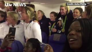 Team GB sing 'God Save the Queen' on plane home