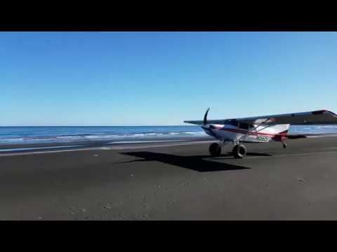 Beach takeoff from remote Alaska island