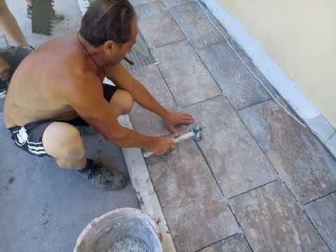 Posa mattonelle gres porcellanato terrazzo. - YouTube