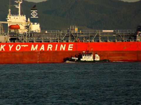 "Columbia River Bar Pilot getting on ship ""Spring Ursa"" at Astoria, Oregon."