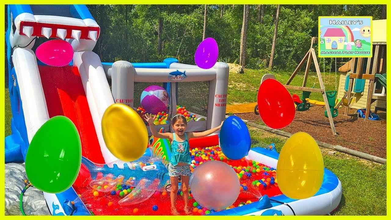 Huge Eggs Surprise Toys Challenge On Inflatable Shark Park