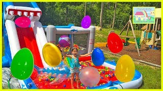 Huge Eggs Surprise Toys Challenge on Inflatable Shark Park Water Slide! Outdoor Play