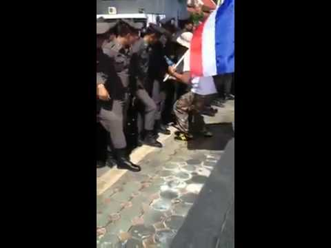 playing with cops dick during Thai protest